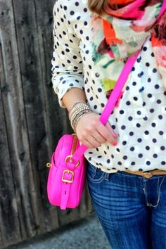 Polka dot shirt, colourful scarf and bright pink shoulder bag