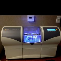 Super cool machine David's practice (Gardens Dental Care) has that can make a crown in one visit.  Cerec machine