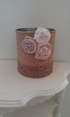 Thrifty Treasures Reuse a large tin can by decorating it with twine and fabric flowers.  Great for storage or a planter