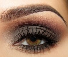 Smoky gray, burgundy, peach/pink... really emphasizes hazel eyes. Nice!