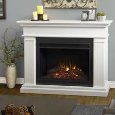 This exclusively designed Kennedy Grand Electric fireplace is generous in scale with a unique and stylish diagonal firebox. Vivid Flame remote control settings emit up to 5,100 BTUs per hour and features a lovely white coloration.