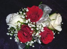 Red and white roses, white Baby's breath wrist corsage