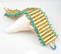 Hand-crafted bracelet made with turquoise beads, brass wire and recycled bullet shell casings. by priscilla