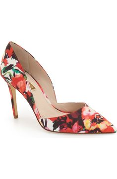 This sophisticated d'Orsay pump is covered with a gorgeous, red-hued floral pattern for a cheerful look.