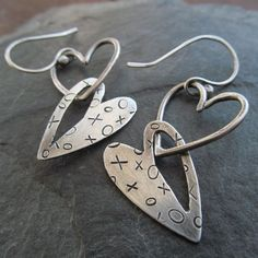 Graphic and fun double heart earrings perfect for Valentines Day or any time. All hand cut and fabricated out of sterling silver. Stamped with Xs and Os. They measure approximately 1 1/2 inches long (not including ear wire) by 3/4 inch wide. Due to the handmade nature of this item, each pair will be slightly different.