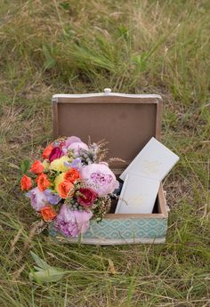 This vintage inspired wood suitcase is a lovely decorative piece for a Vagabond chic wedding!