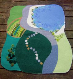 This listing is reserved for Amy. Please do not buy it unless you are her. If you would like your own custom-made wool playmat, please see here: https://www.etsy.com/listing/111815212/custom-made-felted-wool-waldorf-playmat *~*~*~*~*~*~*~*~*~*~*~*~*~*~*~*~*~*~*~*~*~*~*~*~*~*~*~*~*~*~*~*~*~*~*~*~*~*~*~*~* A 3 x 4 playmat with curved edges. It has a garden with crops and flowers, lots of greenery, a sea & rocky shore, a road, and a rock path. I hope you and yo...