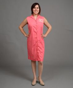 ($21.00) This mid century dress is as wearable as it is cute! This dress features buttons all the way up the front and a large embroidered monogram in a classic font.  This dress fits like a women's medium (6/8). Measurements: Bust- 37in Waist- 36in Hip- 38in  Keep in mind that the arm holes on this dress run small.  The model shown is a size 6/8.