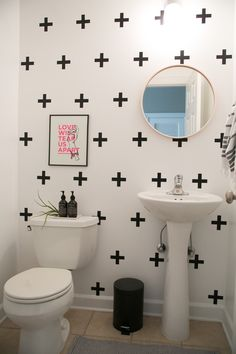If you can't paint or wallpaper, play with removable wall decals.