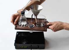 coffee-making alarm clock wakes you up with a freshly brewed mug - designboom | architecture & design magazine