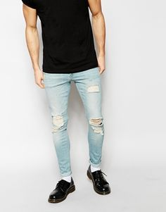 Ripped jeans add a really cool and casual twist to a smart outfit. Team these with a black t-shirt and a blazer for a great night out look.