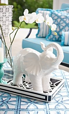 Embellished in elaborate artistry and striking a celebratory pose, our Ceramic Elephant appears ready to lead a ceremonial procession.