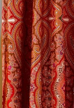 A traditional paisley pattern in warm russet tones gets a contemporary update with a boost in scale in this vibrant shower curtain. About $40; Echo Design