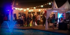 Pool fountain, string lights, canopy with draping Paris theme