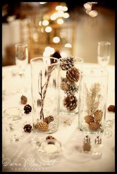 Beautiful and simple centerpiece...I could easily change it to make it work for our beach wedding