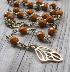Hey, I found this really awesome Etsy listing at https://www.etsy.com/listing/202480718/butterfly-wing-artisan-rosary-rock-n