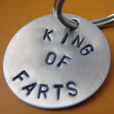 "King of Farts dog tag. $10.00, via Etsy. -I can also do ""QUEEN OF FARTS"" and any other stamping you should want, including name/phone"