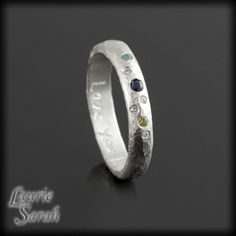 Genuine Blue Sapphire, Peridot, Blue Topaz, and Diamond Hammered Finish Mothers Ring in Sterling Silver - LS2718. $225.00, via Etsy.