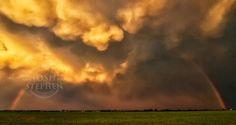 Golden hour Sunset with gigantic rainbow under a massive mammatus cloud layer.  #thunderstorm #rainbow #oklahoma #severe #supercell #goldenhour