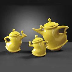 There's something very Alice in Wonderland about these! Howard Elliott 1885 Contemporary Yellow Glazed Ceramic Teapots - set of 3 - 1885 from BEYOND Stores Tea Pot Set, Pot Sets, Teapots And Cups, Ceramic Teapots, My Cup Of Tea, Chocolate Pots, Glazed Ceramic, Mellow Yellow, Color Yellow