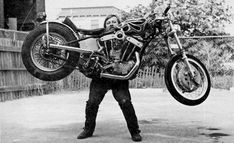 """1970s Harley 45 Magnum, Randy Smith - """"Because he can.  And back then it might get ya' a boob flash. In a Herculean effort to prove the 45 Magnum is a lightweight, Randy Smith hoists 203 pounds of machine off the ground, solo. The whole 45 magnum weighs only slightly more than a unit Sportster engine. """""""