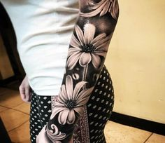Flowers tattoo by Hugo Feist