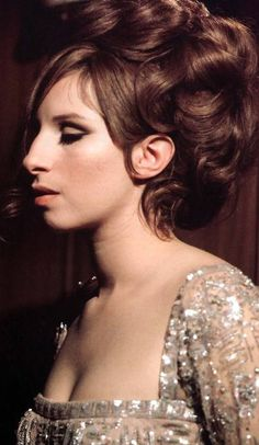 The Pez Dispenser - Barbra Streisand in the late 60s.  Known for her distinctive looks and powerful voice