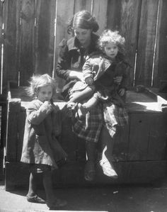 A girl watching over her sisters in a pre-war Jewish ghetto area. Photograph by John Phillips. Warsaw, Poland, 1938.