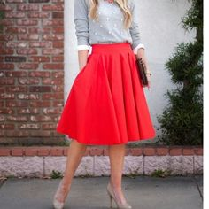 Red Full/A-Line Midi Skirt Pretty full A-line skirt in red. Front pleats. Back zipper. Fully lined. First pic is for styling purposes only.Length: 24 inches Waist: 13 inches Materials: 100% Polyester, Lining 100% Polyester. Brand new. ❌NO TRADES❌ The Limited Skirts A-Line or Full