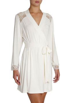 <p>95% Modal / 5% Spandex with 94% Nylon / 6% Elastane Lace - Wrap front robe style - Lace shoulder yoke and cuff band - Attached wide belt sash - Imported - Hand wash cold</p>