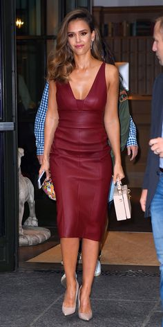 Jessica Alba traded in her daytime-bright pink Narciso Rodriguez dress for an evening look also by Narciso Rodriguez. She wore the designer's pomegranate stretch nappa leather dress, styling it with a cute top-handle lunchbox purse, gold Rachel Katz earrings, and neutral pumps.