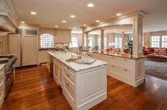 Traditional Kitchen with Kitchen island, Undermount sink, Arched window, Flat panel cabinets, U-shaped, Crown molding