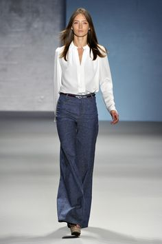 Great tailored 70's look with wide trouser jeans, wedges, and a crisp white shirt
