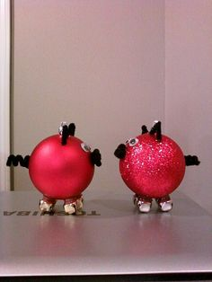 My razorback christmas ornaments i made. This was before I put a White A on the side of the matte one.