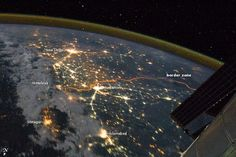 India-Pakistan Borderlands at Night.    Clusters of yellow lights on the Indo-Gangetic Plain reveal numerous cities large and small in this astronaut photograph of northern India and northern Pakistan. Of the hundreds of clusters, the largest are the capital cities of Islamabad, Pakistan, and New Delhi, India.