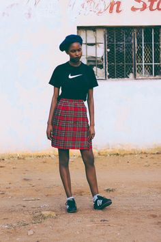 Refilwe Mnindwa. Picture by bunnywaylah | adidas top, sneakers and plaid skirt | street style inspiration