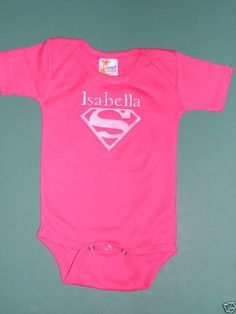 BABY PINK T-SHIRT ONESIE SUPERGIRL + PERSONALIZED Various Sizes High Quality Cotton: Supergirl Logo embroidered on the front and baby's name embroidered too! High quality 100% cotton onesie. Available in Sizes: 0-3, 3-6, 6-12 and 12-18 mos. Email me with the size you need and the name you want embroidered at: MJLHerbalife@aol.com...