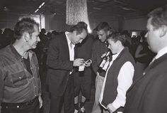 Nicholas Cage signs an autograph for a fan while attending the 15th Virginia Film Festival in 2002.