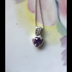 Sterling Silver Amethyst Heart Necklace Cute little necklace chain marked .925 Italy FAS and pendant marked .925 FAS cannot phtograph markings as they are too small my camera will not capture that all I have is a phone camera. It was purchased at a jewelry store by my grandson for his girlfriend and they broke up and he wants me to sell it for him. I don't know if it's a amethyst or synthetic stone but it is a pretty purple color and has little rhinestones or diamonds around it. The chain is…