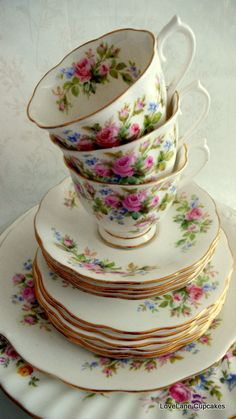 Floral teacups, saucers, and plates.