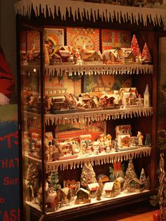 Christmas Village Displayed In A Curio Cabinet With Led