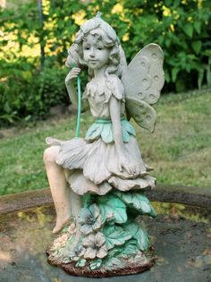 Fairy Wings in the Garden:  How fairy statues can enhance your lawn and patio.