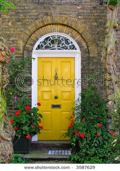 English front door, surrounded by flowers