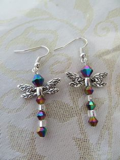 Iridescent dragonfly earrings by JewelInfinityBeyond on Etsy