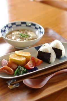 Japanese Lunch Meals with Nori-wrapped Onigiri Rice Ball, Tamagoyaki Omelet, Tofu Soup