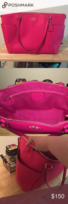 coach purse Hot pink, leather, large pockets on both sides of the exterior, zips completely shut, pockets inside. Coach Bags Shoulder Bags