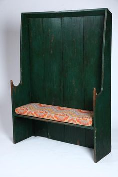 """SETTLE BENCH.   American, 20th century, maple and pine. Well-shaped one-board sides, green paint and single cushion. 66 1/2""""h. 48""""w. 15 1/2""""d.     Based on an example in Kettel's Pine Furniture of Early New England."""