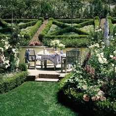 Use a slope to create garden art! Here, boxwood hedges create a visual masterpiece on a slope. The blue fescue between the hedges adds a fun contrast in form and color. Planting on the slope enables you to view the distinct planting pattern while enjoying a meal on the patio....so nice!!