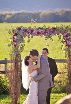 The couple exchanged vows under a lavender-colored floral arbor. Rebekah J. Murray Photography.