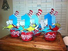 Dr. Seuss themed centerpieces. #1 cutouts with fish and hat cutouts ordered from Amazon.